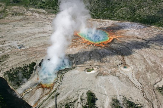 An aerial photograph of Excelsior Geyser and Grand Prismatic Spring in the Midway Geyser Basin, Yellowstone National Park, Wyoming, June 22, 2006. Image courtesy Jim Peaco/Yellowstone National Park. (Photo via Smith Collection/Gado/Getty Images).
