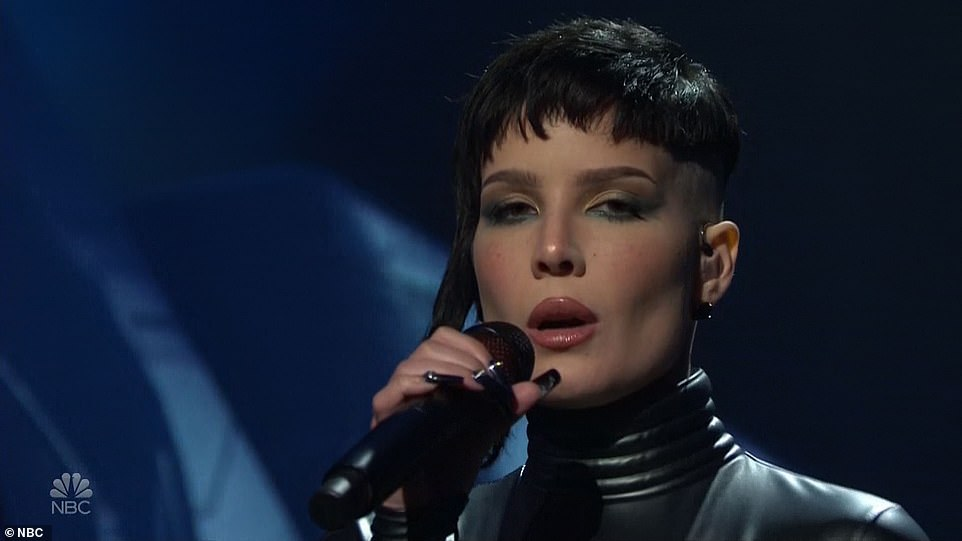 From the future:The singer, who came out as nonbinary and uses they/them and she/her pronouns interchangeably, sang to the pulsing beat with an abstract background inspired by science fiction films