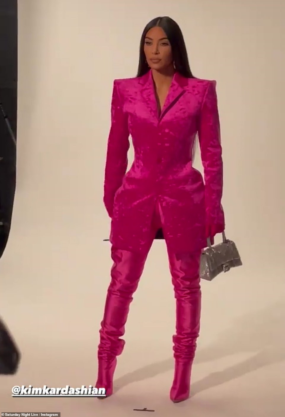Pretty in pink: The long-running sketch comedy show announced a social takeover earlier this week, and Kim commenced to share a short video of herself in a hot pink crushed velvet suit