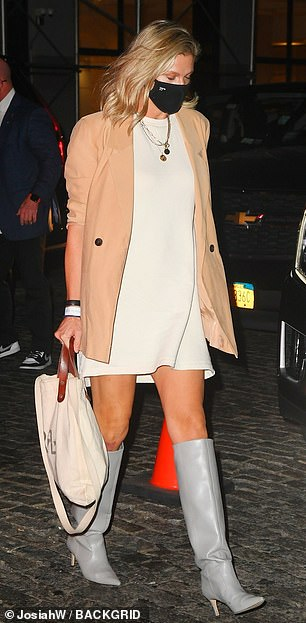 Looking good: SNL producer Lindsay Shookus wore a stylish thigh-skimming skirt and grey leather boots as she arrived at New York nightspot Zero Bond