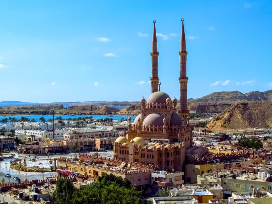 Top view of the Old City, Al Mustafa Mosque and the Red Sea in Sharm El Sheikh. Beautiful panorama of the Egyptian tourist city on a background of mountains