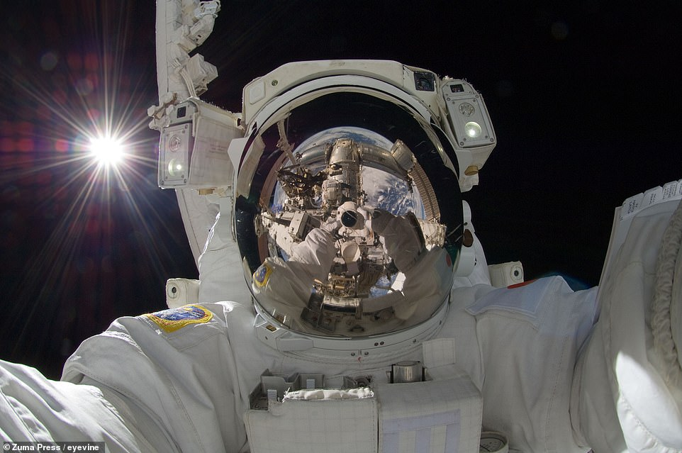 Japanese Aerospace Exploration Agency flight engineer Akihiko Hoshide takes a selfie with a digital still camera during a six-and-a-half hour spacewalk for repair work on September 5, 2012 - three months into the 32nd long-duration expedition to the satellite. The Earth and the International Space Station (ISS) can be seen reflected in Hoshide's helmet visor, along with fellow astronaut Sunita Williams of NASA, while the Sun shines brightly over his right shoulder.
