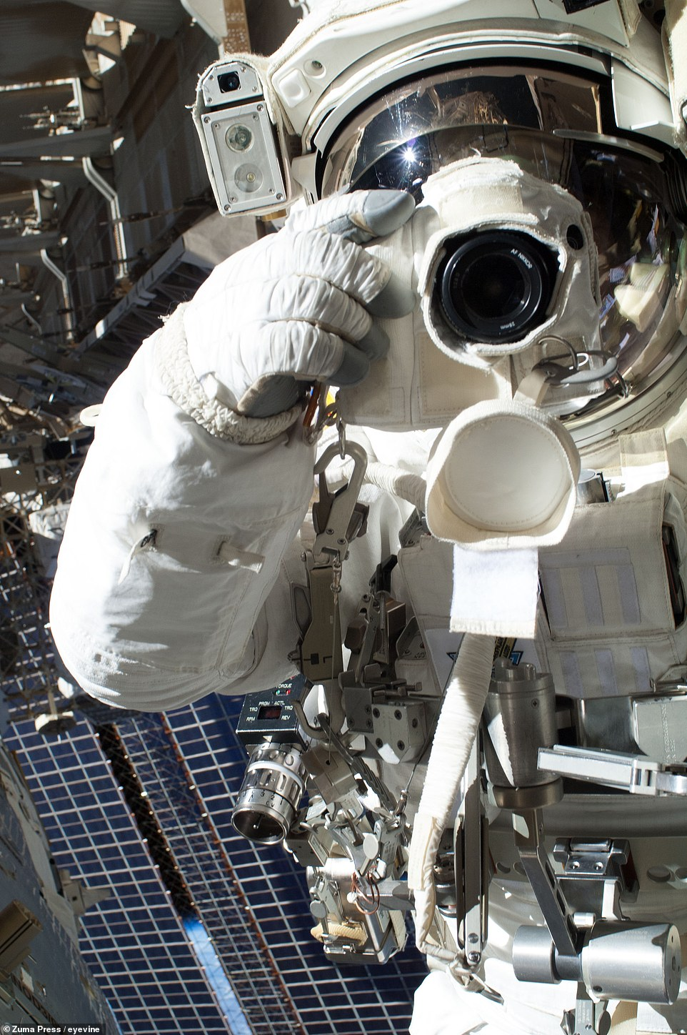 Chris Cassidy of NASA snaps a selfie with a digital camera on July 16, 2013, before his spacewalk was cut short after barely more than an hour. Fellow astronaut Luca Parmitano (who is out of the frame) had reported water floating behind his head within his helmet. Although the water presented no immediate risk, Mission Control elected to end the EVA early.