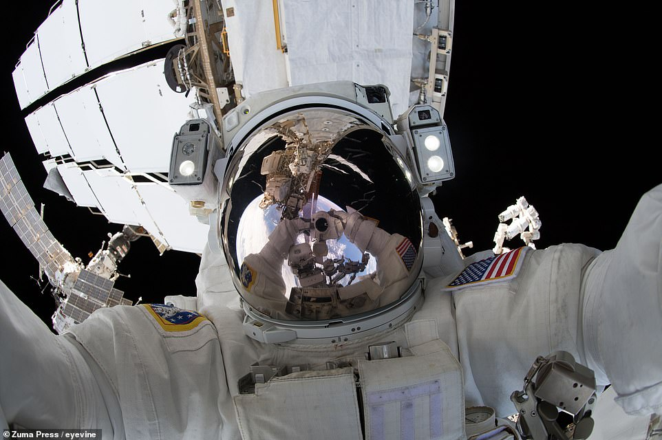 Ricky Arnold is pictured here on June 14, 2018. This spacewalk's purpose was to install high definition cameras to better track commercial crew spacecraft - such as the Boeing Starliner and the SpaceX Crew Dragon - as they come in to dock with the ISS.