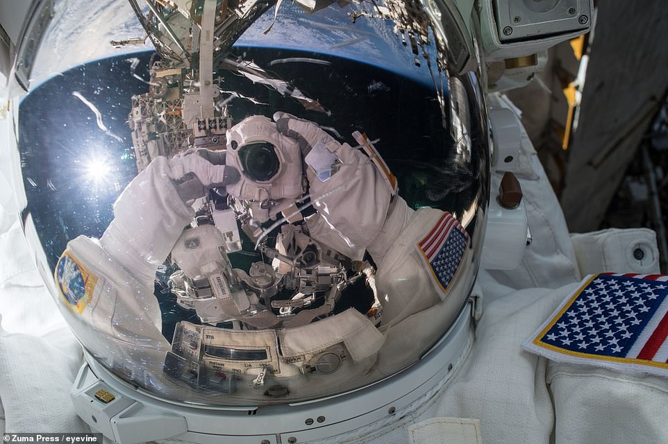 NASA's Ricky Arnold poses for a selfie during an EVA to install wireless communications antennas onto the outside of the ISS's Tranquillity module on March 29, 2018.
