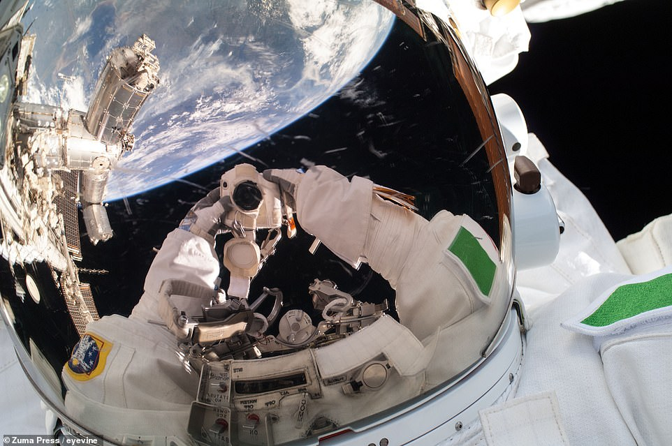 European Space Agency Astronaut Luca Parmitano takes a quick selfie break during work to perform minor installations on the ISS's backbone and prepare the station for the impending addition of a new Russian module.