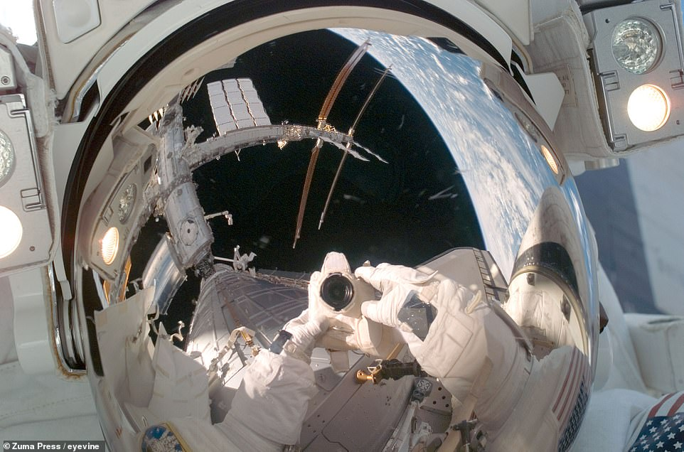 NASA Astronaut Mike Fossum poses for a snap during a near-seven-hour spacewalk to prepare the core pressurized section of the Japanese science module 'Kibo' for attachment to the ISS on June 3, 2008.