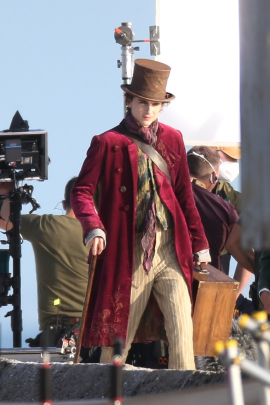 Timothee Chalamet, Matt Lucas and Paterson Jospeh are seen filming scenes of 'Wonka' directed by Paul King. The story will focus specifically on a young Willy Wonka (Timothee Chalamet) and how he met the Oompa-Loompas on one of his earliest adventures. Pictured: Timothee Chalamet Ref: SPL5265237 111021 NON-EXCLUSIVE Picture by: Dean / SplashNews.com Splash News and Pictures USA: +1 310-525-5808 London: +44 (0)20 8126 1009 Berlin: +49 175 3764 166 photodesk@splashnews.com World Rights,