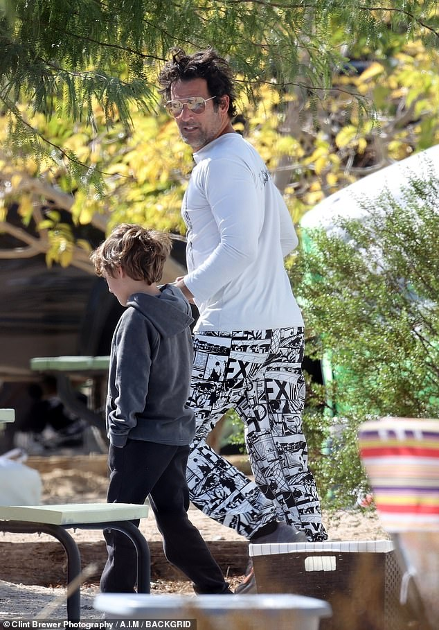 Dad duties: Sean, 47, rocked a black-and-white pair of graphic slacks to match a white long-sleeve shirt