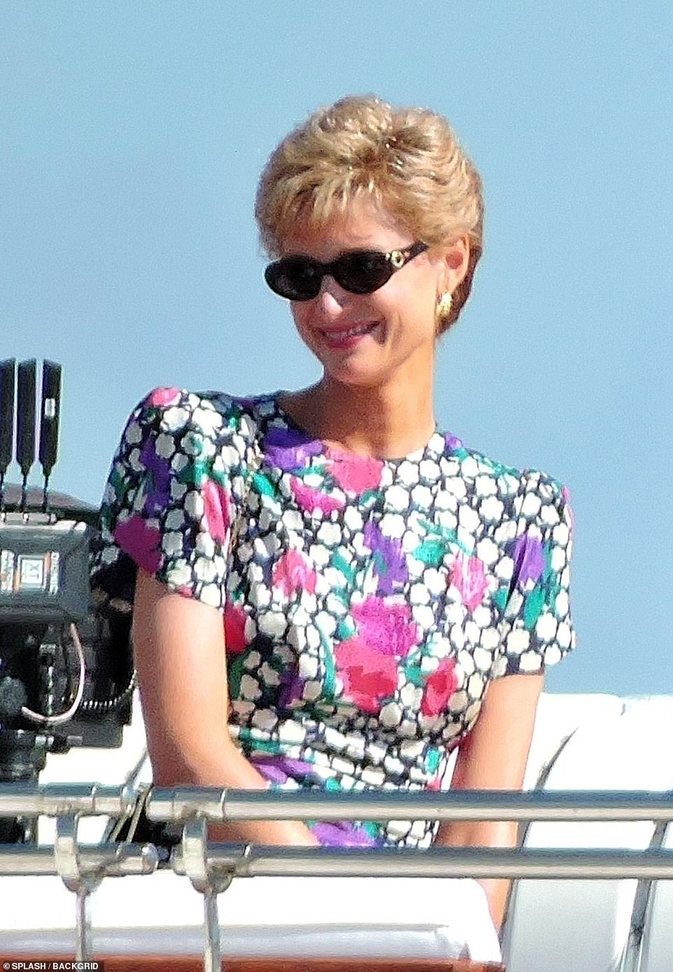 Iconic look: Elizabeth looked like Diana in the pretty dress and sunglasses as she filmed the scenes