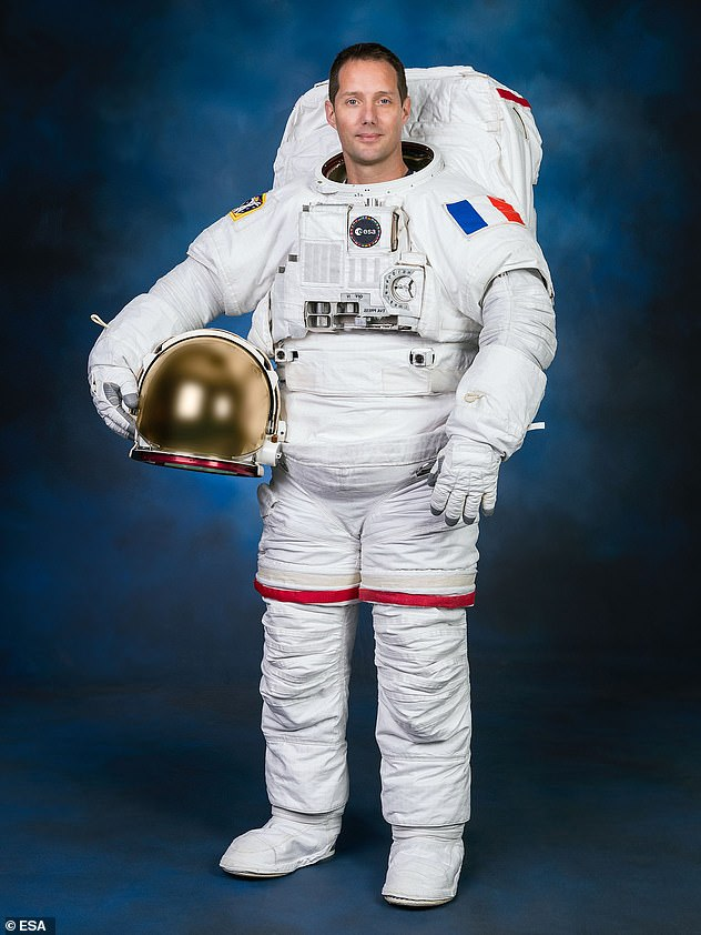 Thomas Pesquet, pictured here in 2020 prior to his second stint aboard the ISS, isone of 10 humans aboard the space station right now