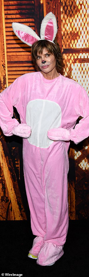 The look: The reality star debuted a large pink bunny suit that came complete with ears and a detached scary mask for the premiere at the TLC Chinese Theatre on Tuesday