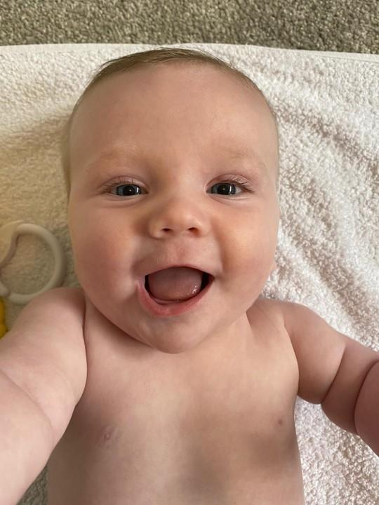 Baby Kobe smiles for the camera