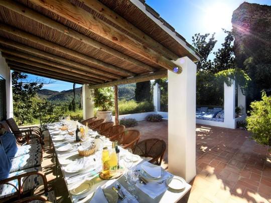outdoor dining table terrace in torre de tramores in marbella