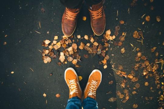 Outside couple autumn leaves walking shoes