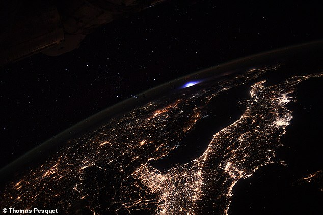 Image posted online by Thomas Pesquet shows the ethereal blue transient luminous event in the upper atmosphere over Europe