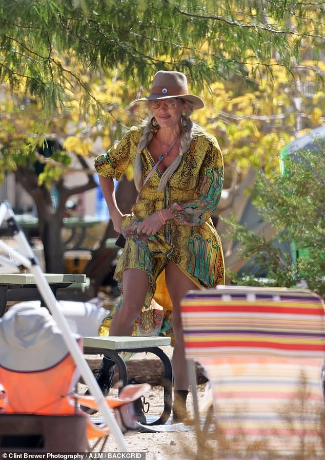 Hanging out: Braunwyn Windham-Burke appeared to be re-connecting with her family as she enjoyed the sights and sounds of the Joshua Tree music festival last weekend