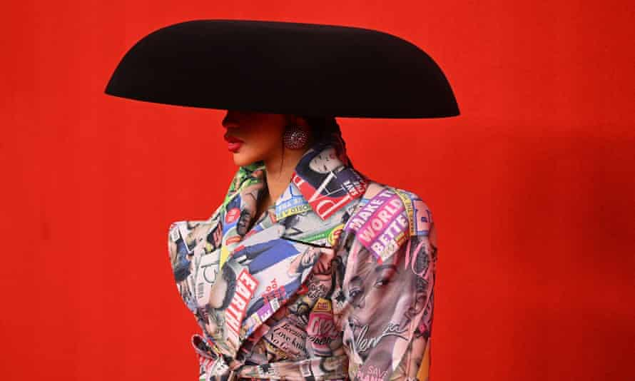 Cardi B wears a dress printed with gossip magazine covers at the Balenciaga show