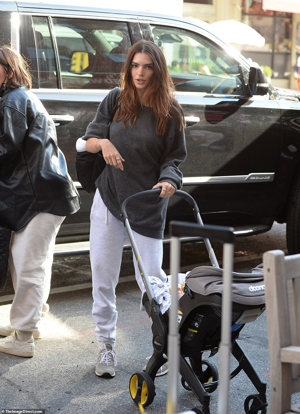 Emily Ratajkowski has been spotted returning to her home in New York City after accusing Robin Thicke of groping her bare breasts during the making of the music video for his infamous 2013 hit Blurred Lines