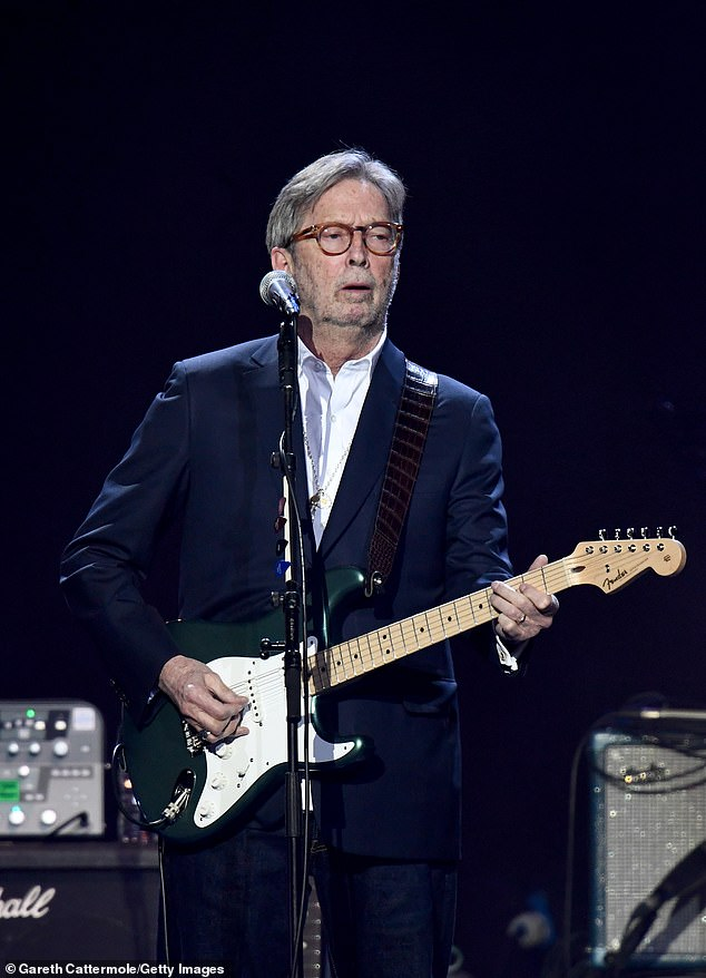 Contribution: Eric Clapton, 76, donated more than $1,300 to the anti-vaccine band Jam for Freedom via GoFundMe and and even lent the members the use of his family's van to tour in, Rolling Stone reports; seen in March 2020 in London
