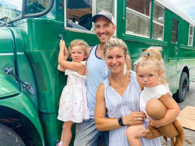 Elizabeth Stone and her partner Spike Stone with their children Pepper and Violet with the finished bus