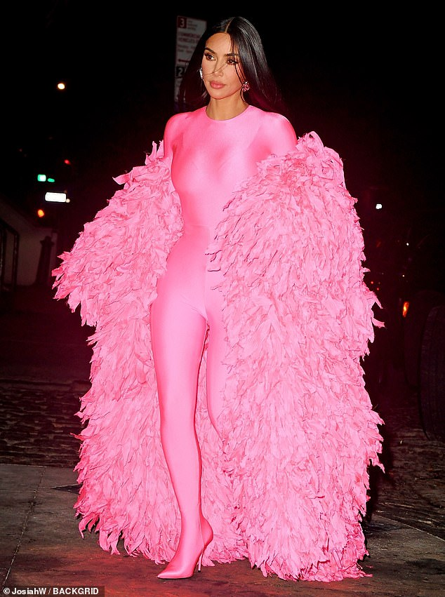 Pretty in pink: Kim Kardashian, 40, emerged in a pink skintight spandex bodysuit and a dramatic ruffled cloak following her first-ever Saturday Night Live hosting gig in New York City