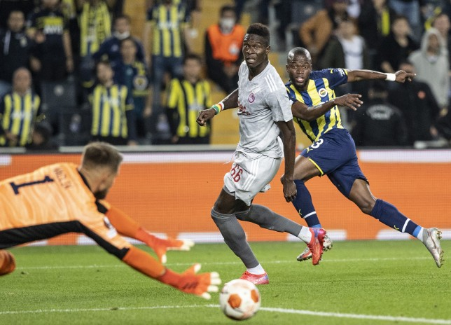 Liverpool transfer target Pape Abou Cisse looks on during Olympiacos' Europa League clash with Fenerbahce