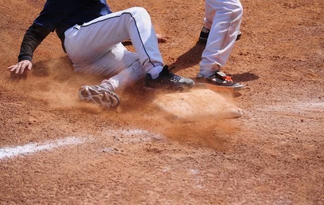 Baseball Player running  sliding Into Base