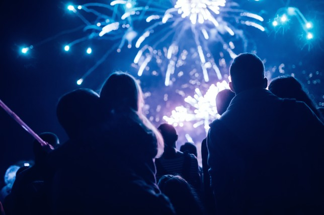 Crowd watching fireworks and celebrating bonfire night