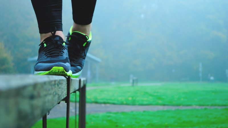 Girl balancing in her sneakers on a ledge outside outdoor recreation stability balance stable