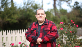 Autistic Adult in front of roses
