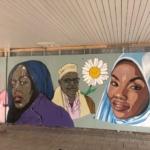 Cherrie, Hadji FFarah och en hijabi målade på väggen.