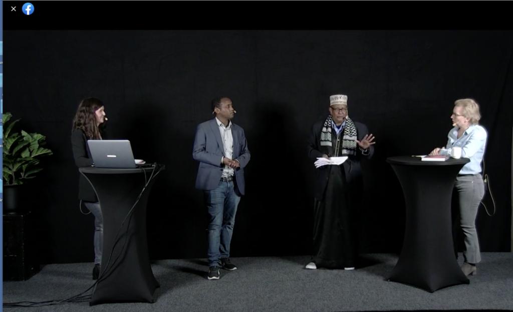 Skärmdump av en paneldebatt.