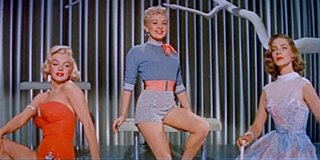 Monroe as Pola, Grable as Loco, and Bacall as Schatze