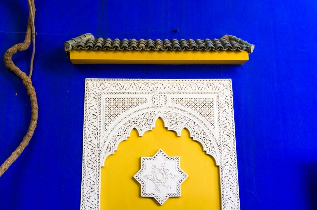 Yellow Door in Morocco on blue wall