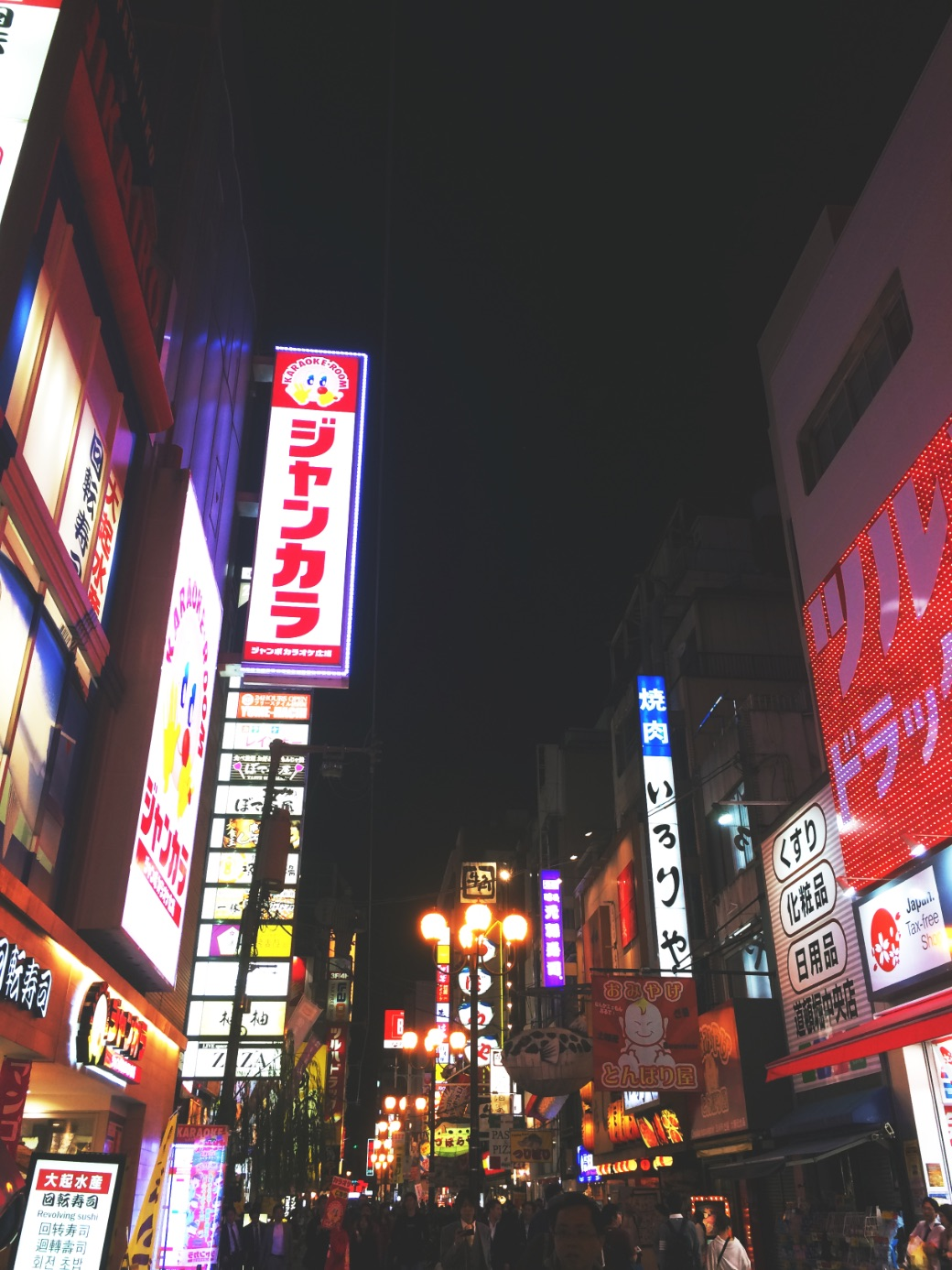 The vibrant atmosphere of Dotonbori street by night in Osaka - Japan
