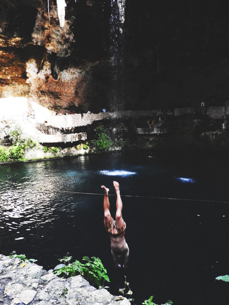 Oliver diving in the refreshing Zaci cenote in Valladolid, Yucatán
