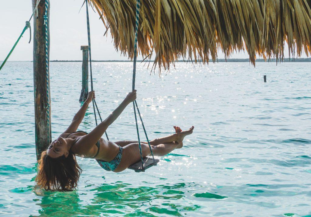Swinging over the lake Bacalar-Yucatán-Mexico