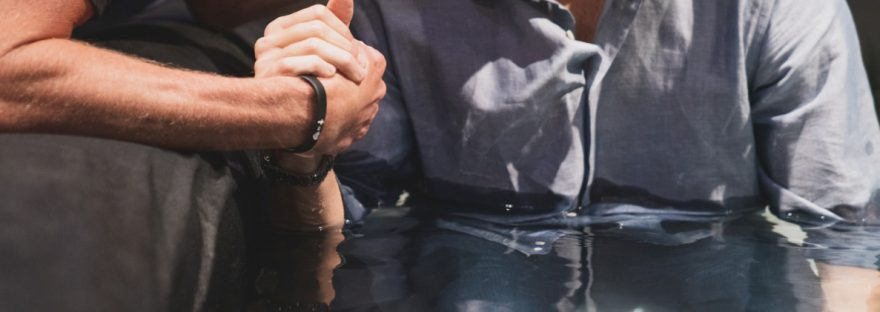 a man getting baptised in water