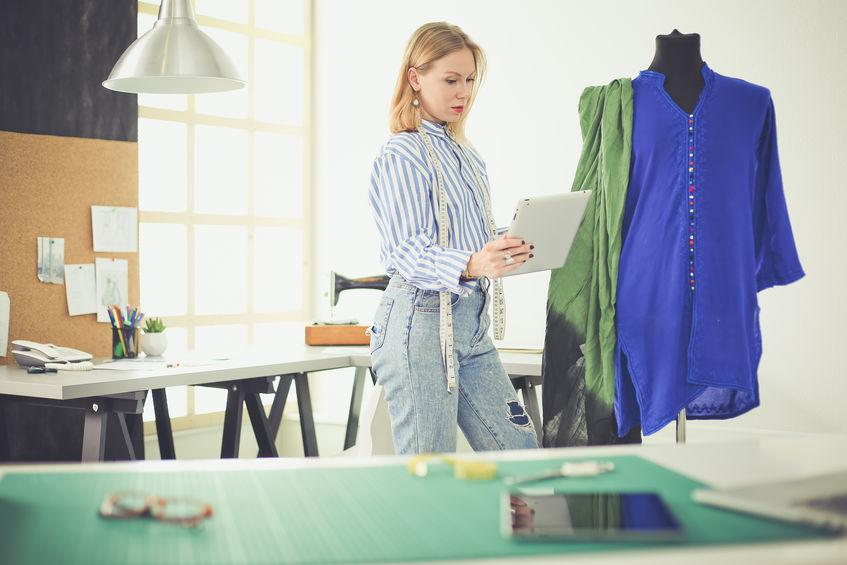 Fashion designer working on her designs in the studio.