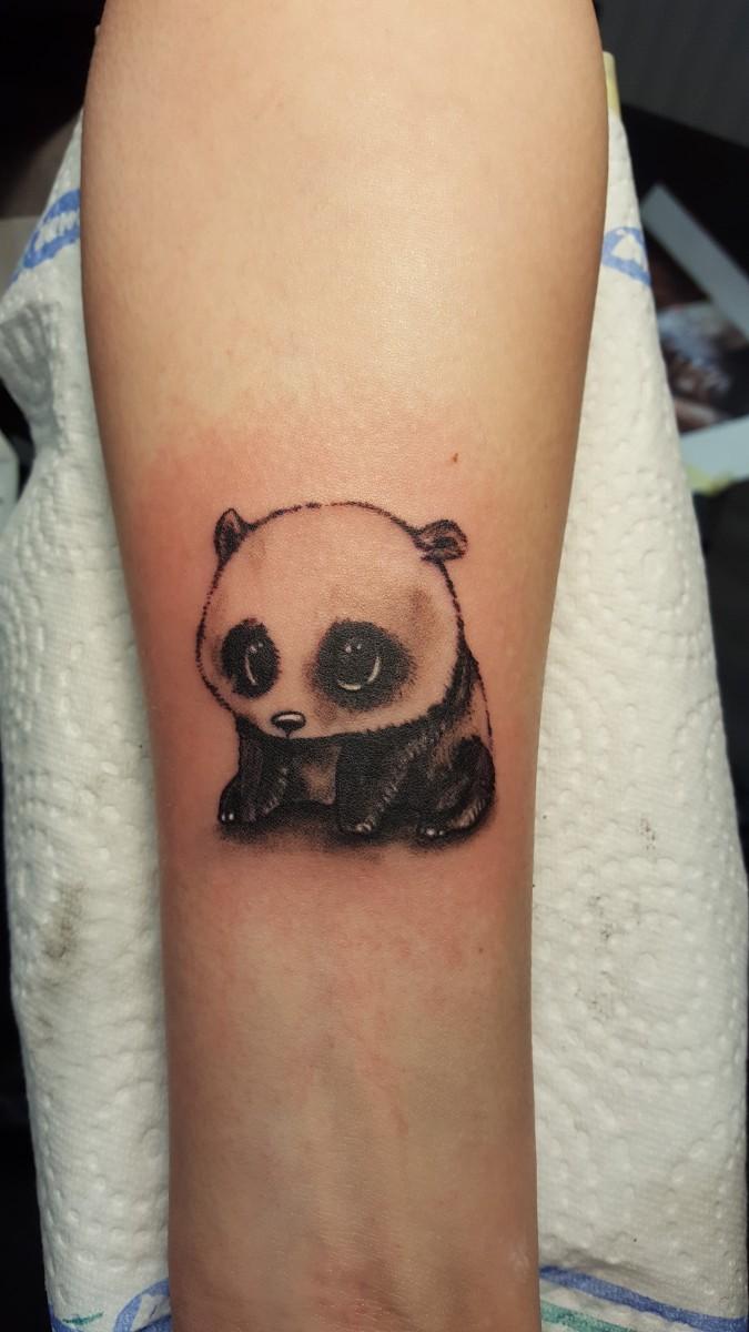 Süßes Panda Tattoo