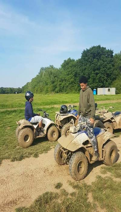young people on quad bikes