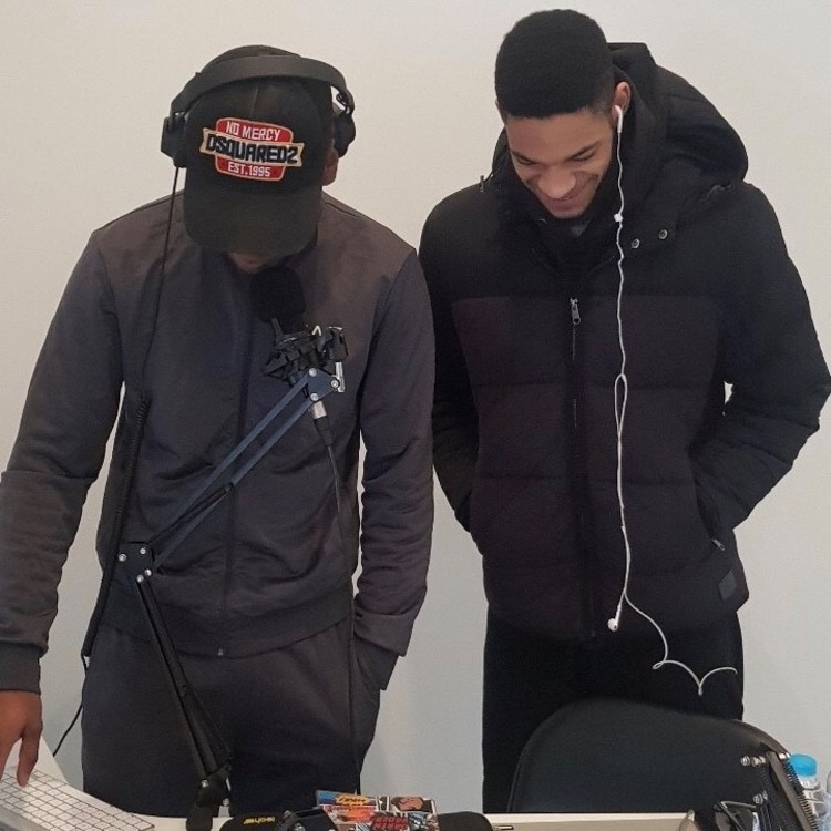 two young black men listening to music