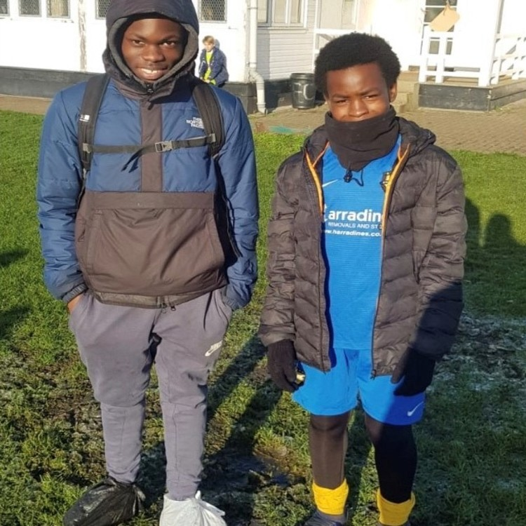 two young football boys