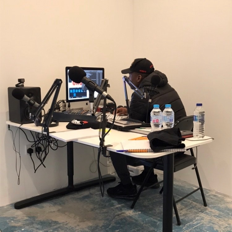 young black man in recording suite