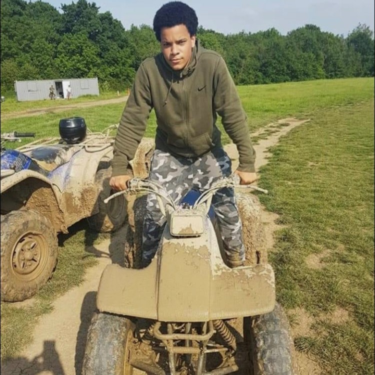 young man riding a quad bike