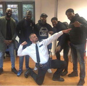 police officer doing Usain Bolt pose