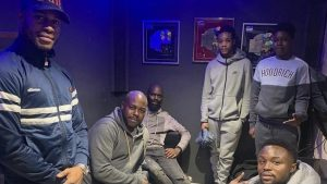 wayne with young boys in a recording studio