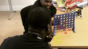 boys playing board games