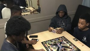 boys playing monopoly
